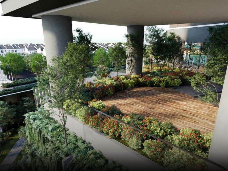 Sân vườn trên cao với bóng cây xanh phủ khắp không gian toà nhà